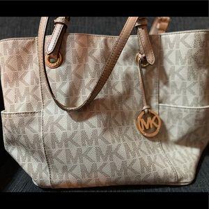 Cream colored Michael Kors purse